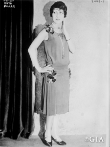 An antique photo of a flapper.