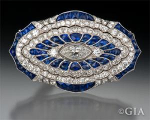 Art Deco platinum, sapphire and diamond pendant/brooch.