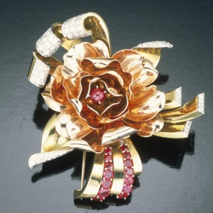 Trabert & Hoeffier Mauboussin rose brooch. Center stone in brooch is a star ruby. Courtesy of GIA & Tino Hammid.