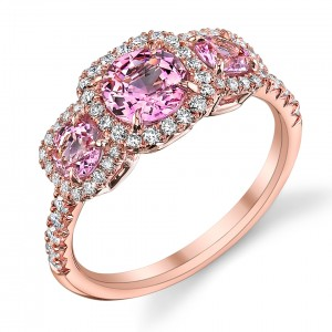 Pink sapphire and diamond 3-stone ring set in 18K rose gold. Image courtesy of Omi Prive.