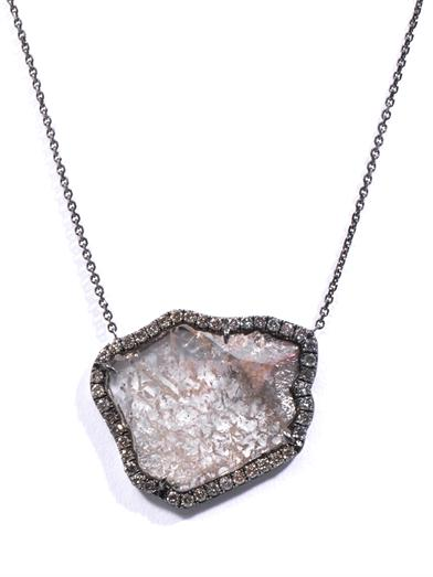 """A diamond slice hangs from an 18ct blackened white gold chain. Designer Susan Foster calls this slate-grey diamond slice design an """"opulent finishing touch"""" for evening wear."""