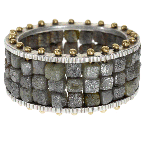 This 20.25 carat diamond bracelet by Todd Reed looks edgy and ancient. The design is raw contemporary, yet the piece resembles a cobblestone road or a Roman fort.
