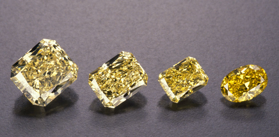 These four yellow diamond master stones mark the most commonly seen lower saturation boundaries of their respective grade ranges. L-R: Fancy Light, Fancy, Fancy Intense and Fancy Vivid. (c) GIA & Robert Weldon