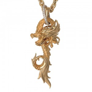 Carrera y Carrera's dragon pendant in yellow gold with a diamond-studded bail.