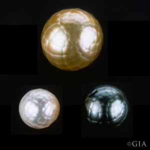 From left to right: a faceted white South Sea cultured pearl; a faceted golden South Sea cultured pearl; and a faceted black Tahitian cultured pearl. Courtesy of Komatsu Diamond Industry