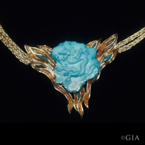 "Elizabeth Beanaiche's ""Dragon Chasing a Pearl"" necklace in turquoise, fire opal, and black opal"