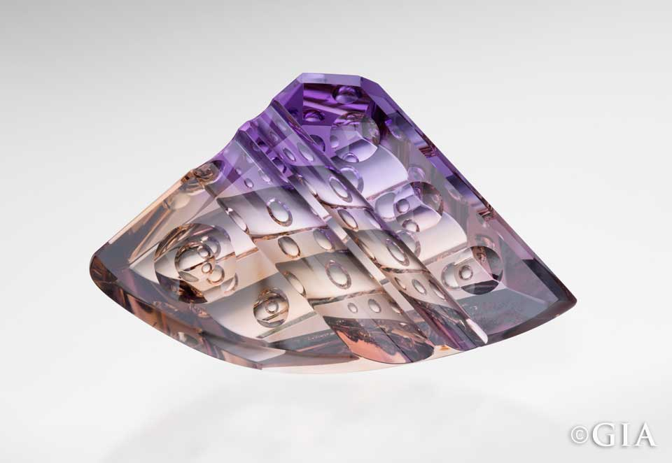 Photo by Robert This 216.06 ct. ametrine from Bolivia, fashioned by Michael Dyber, features the Dyber Optic Dish™ – circular shapes are carved on the crown and pavilion of the gemstone. Weldon/GIA, courtesy Michael M. Dyber, gem designer