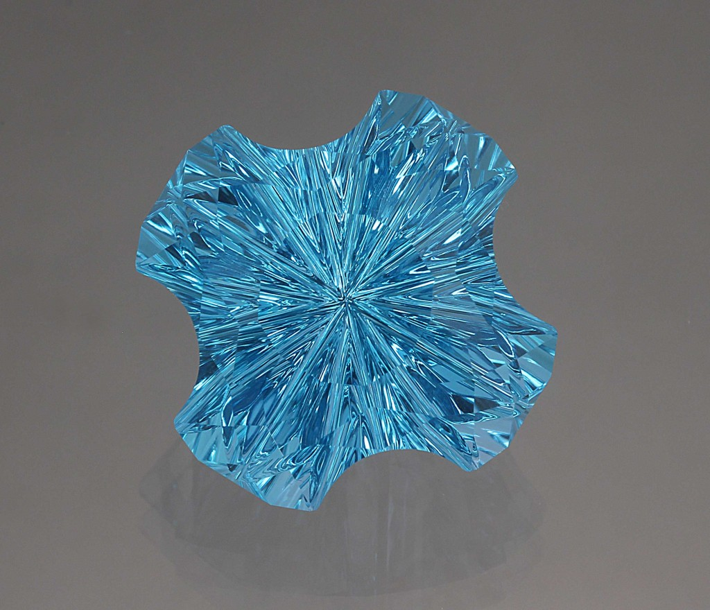 16.07 ct irradiated blue concave faceted topaz. Photo by David Dyer, gem courtesy John Dyer & Co.