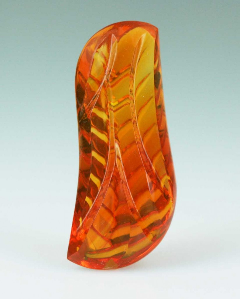 A 20.93 ct fire opal cut by Sherris Cottier Shank. Cuts on the crown and pavilion of gemstone create the appearance of rippling water. Photo © Sherris Cottier Shank
