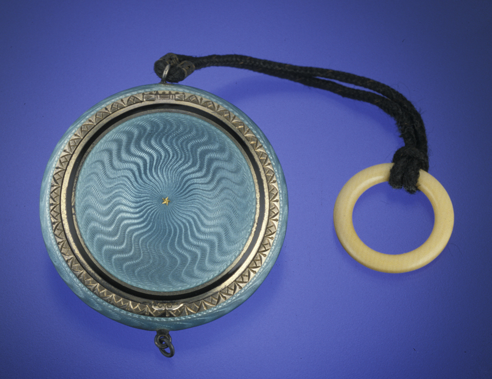 This early 20th-century silver compact is covered with light-blue guilloché enamel. Photo © GIA and Tino Hammid, courtesy Diane Saito.