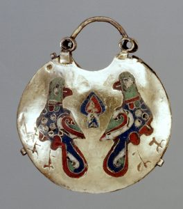 A 12th century Ukranian kolt, or temple pendant to be worn on a woman's headdress. Frequently worn at wedding ceremonies; the lilies (center), birds, and seeds that fleck the birds' breasts are all symbols of fertility. Photo courtesy of the Walters Art Museum, Baltimore