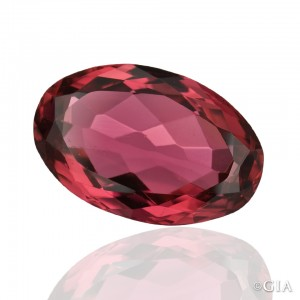 A 7.407 ct oval cut rubellite tourmaline from Madagascar has a beautiful purplish red color. Courtesy of the Dr. Eduard J. Gübelin Collection.