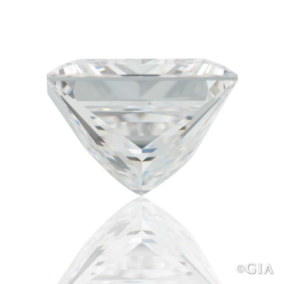 A princess cut diamond with a noticeable pavilion bulge on the right.
