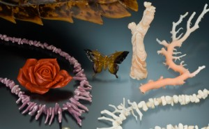 Tortoise shell (upper left), orange coral flower, lavender coral necklace, three cultured pearls, tortoise shell butterfly pin, angel skin coral carving, pink coral branch, a white coral necklace. Photo by Robert Weldon/GIA.