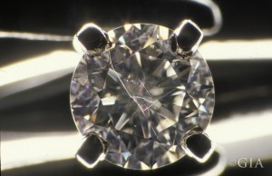 When a fracture filled diamond is left in an ultrasonic cleaner too long, the filling can be damaged – which is what happened to this 0.34 ct treated diamond. Photo by Shane F. McClure/GIA