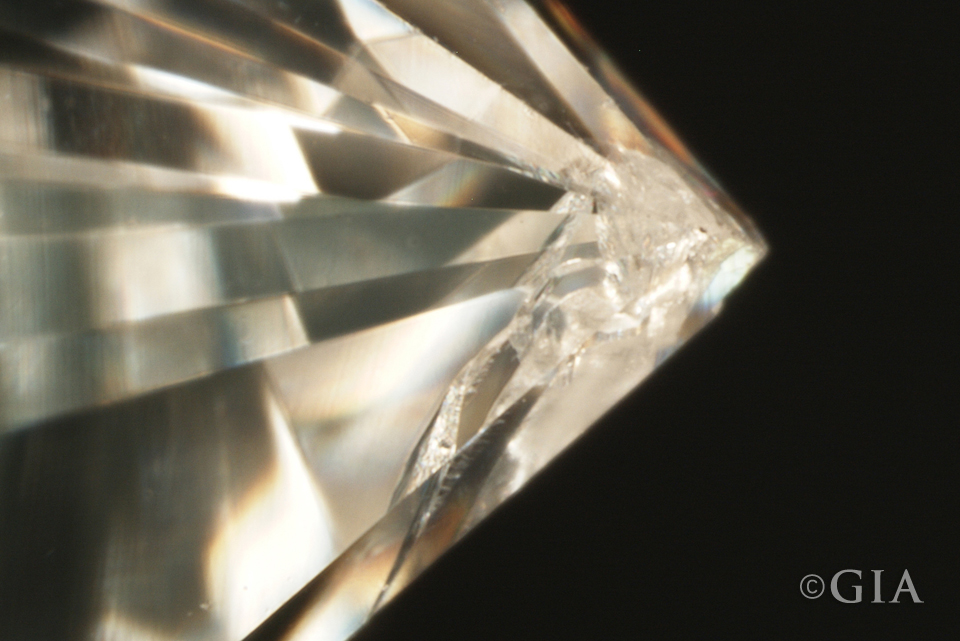 Corners on princess cut diamonds can fracture as seen in this image. Well-placed prongs can protect them.