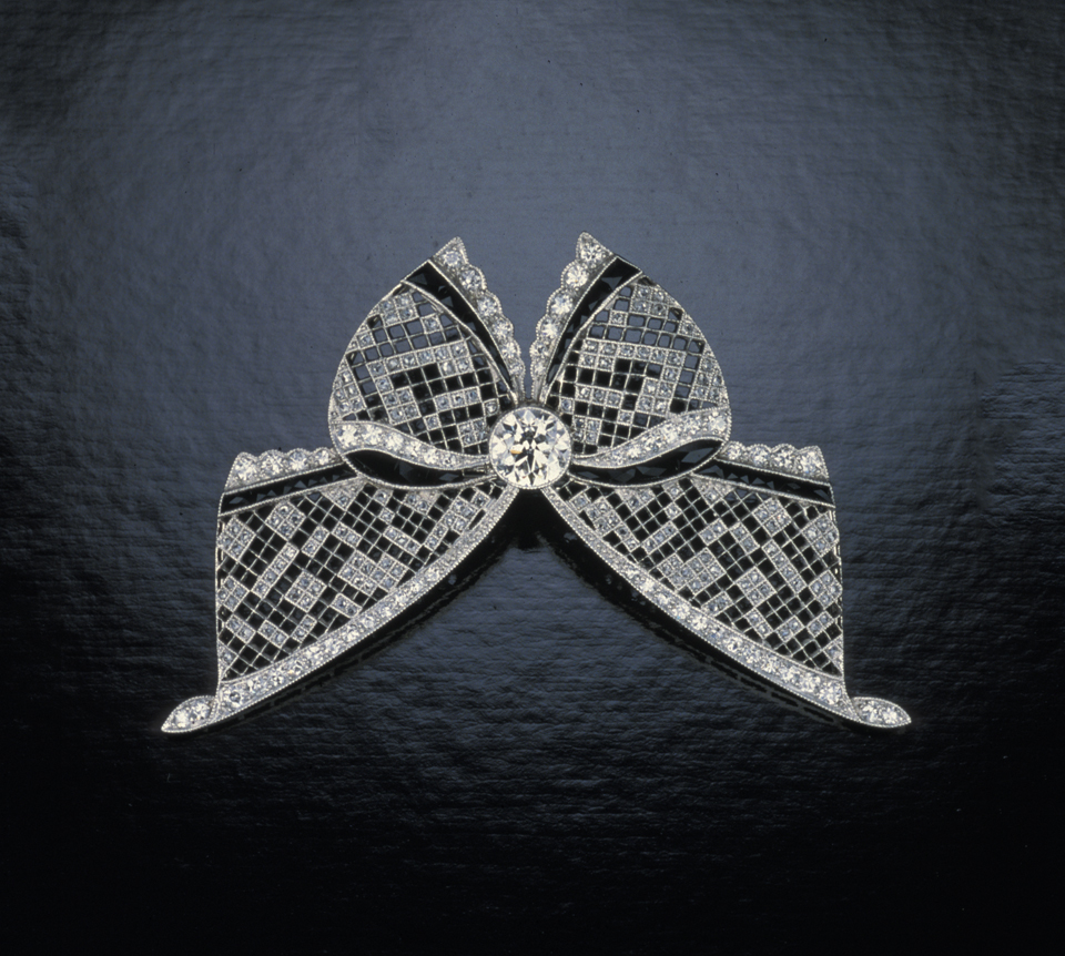Tiffany & Co. platinum and rose cut diamond bow brooch with millegrain work, saw-pierced, and French cut black onyx. Photo © GIA & Tino Hammid, courtesy of Neil Lane, Inc., Beverly Hills