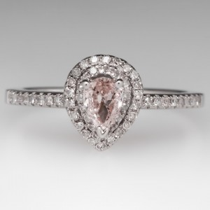 The center stone, a 0.36ct Fancy Light pink pear-shaped diamond, appears larger when set in a double halo ring. Courtesy: www.eragem.com
