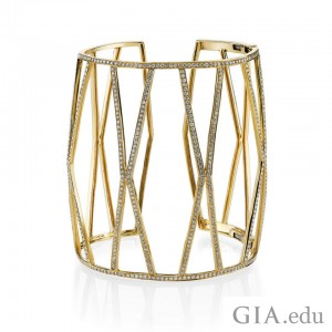 Cuffs can make a great accent piece. Borgioni cuff in 18k yellow gold with pave diamonds. Courtesy: D'Orazio & Associates