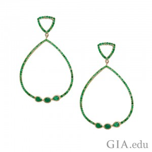 Emerald green is the perfect holiday color. Meredith Marks Tania Teardrop emerald earrings in 14K yellow gold. Courtesy: Jewelers of America.