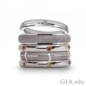 Adorn your fingers in style. STACKED New York stacking bands made with recycled Argentium silver with green sapphires, orange sapphires and yellow sapphires. Courtesy: Jewelers of America