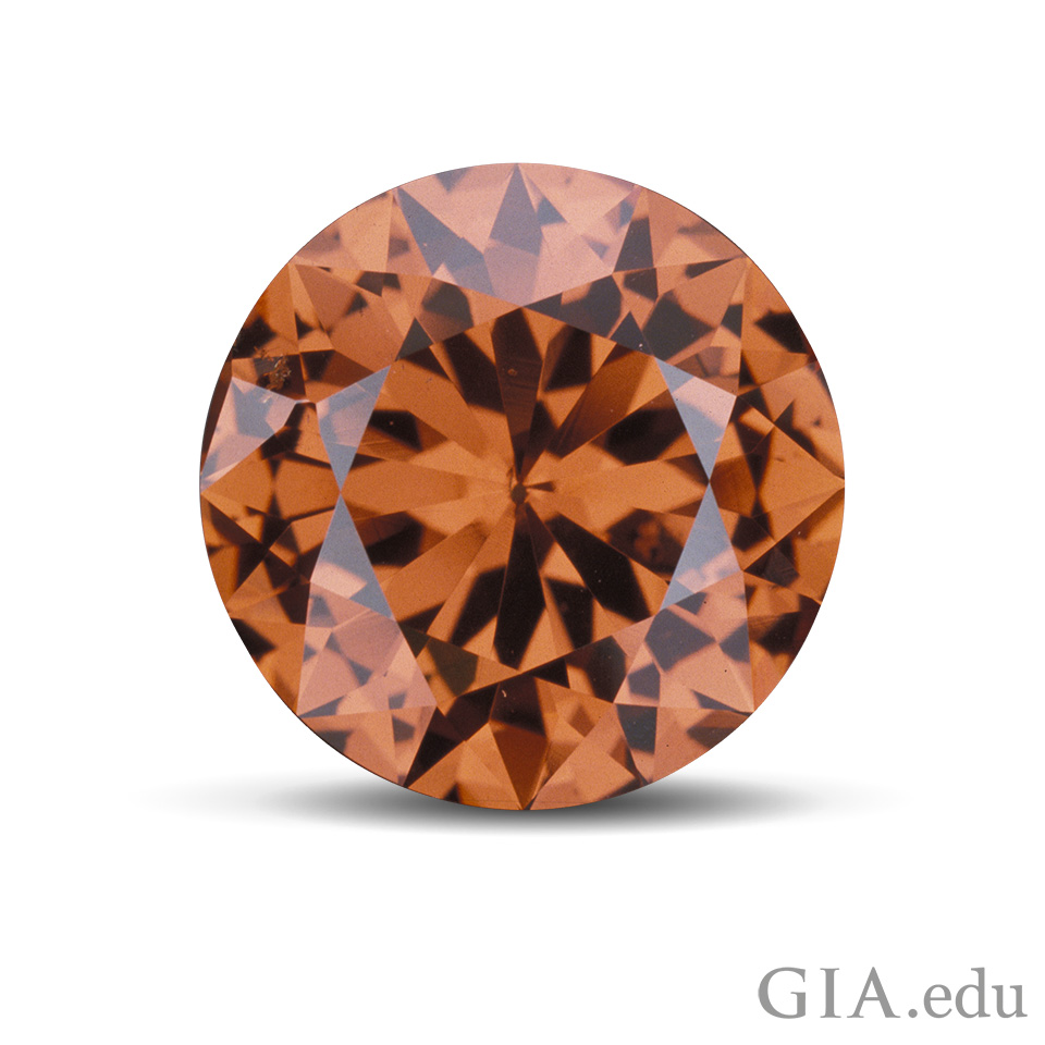 20.90 ct round brilliant Malaya garnet from Tanzania.