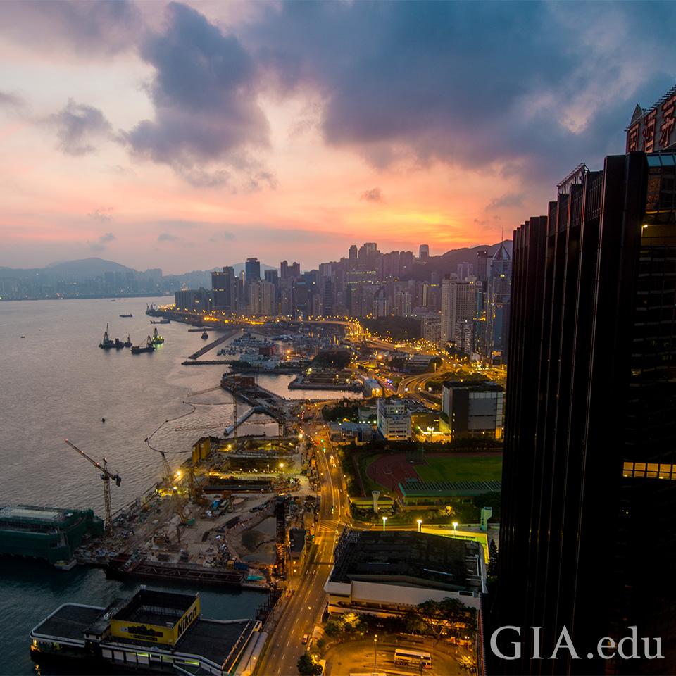 Hong Kong's skyline at the waterfront at daybreak.