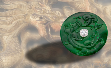 Jadeite jade carved dragon convertible brooch-pendant with a colorless diamond at the center.