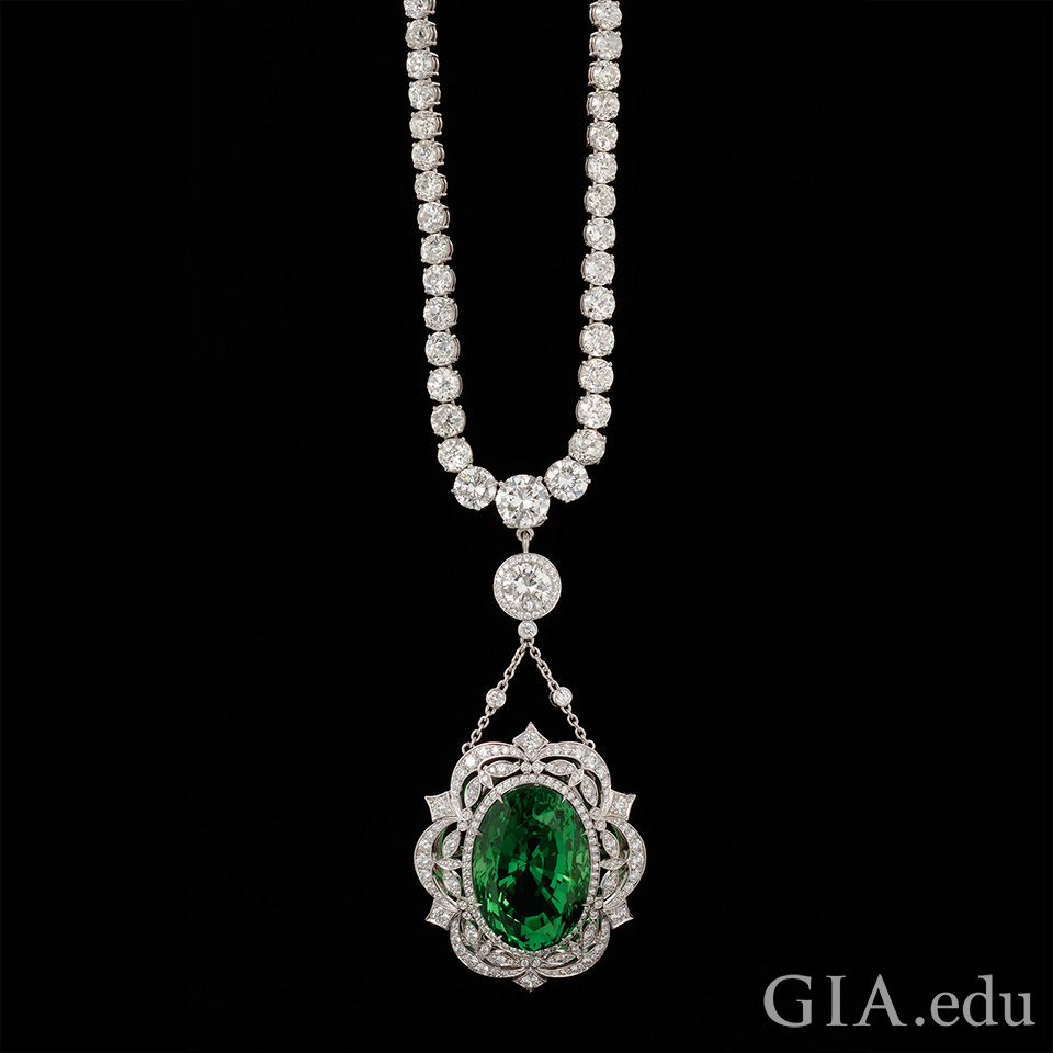 Necklace with 62.81 ct tsavorite framed by diamonds and platinum.