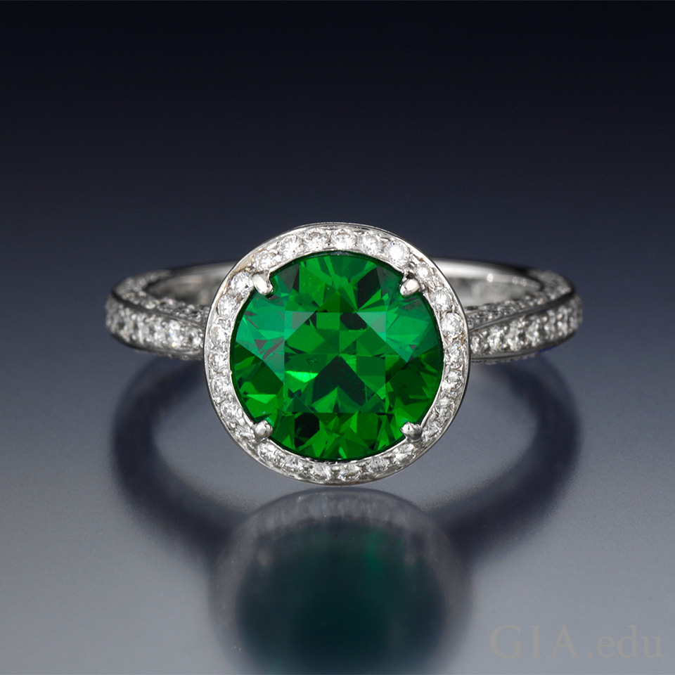 Demantoid garnet and diamond ring.