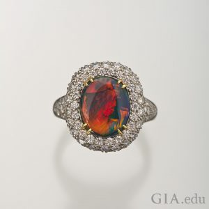 3.09 ct black opal ring with diamond halo
