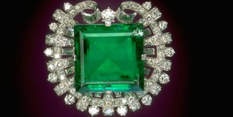 20 baguette cut diamonds circle a 75.47 ct Colombian emerald