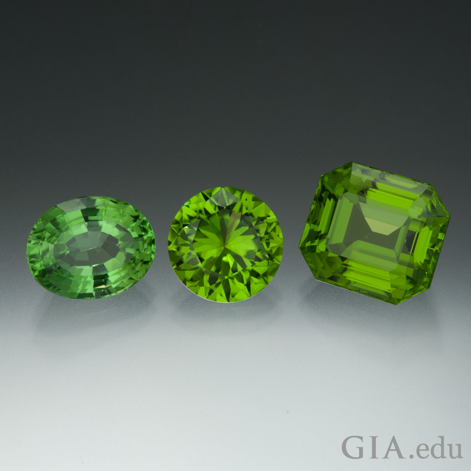 Three mixed cut peridot gems