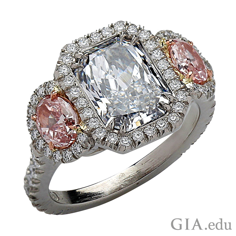 Ring with two pink diamonds and Fancy Light blue center stone