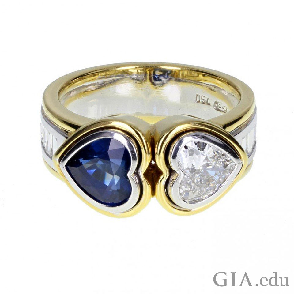 Ring inspired by antique engagement rings featuring heart-shaped diamond and sapphire