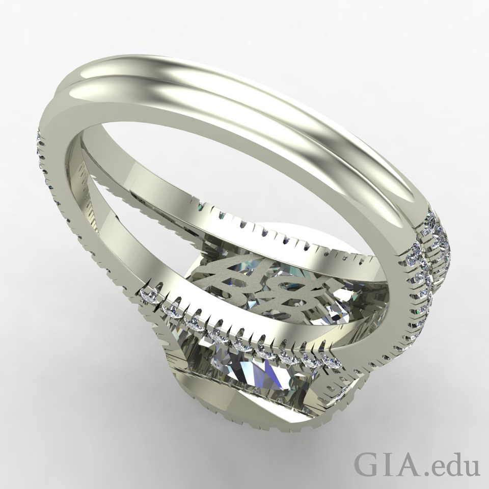 Ring with the couple's initials hidden beneath the center stone