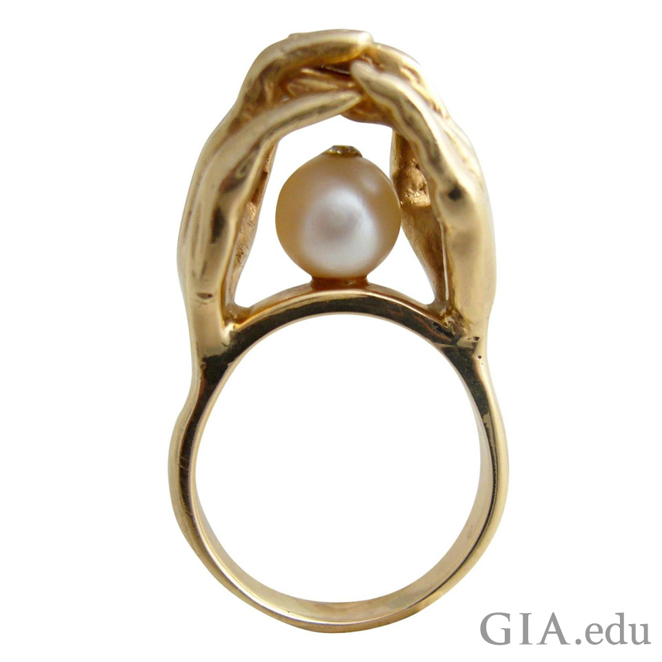 1970's gold ring inspired by an antique engagement ring style