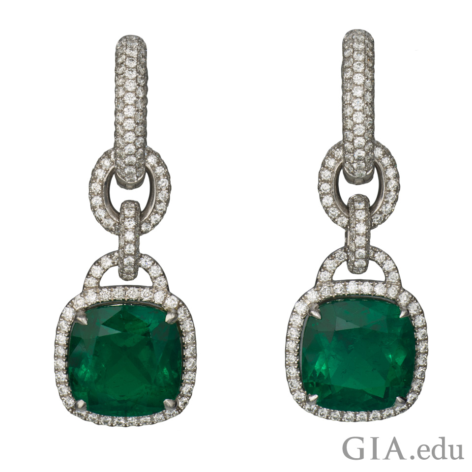 Platinum earrings set with cushion cut Colombian emeralds