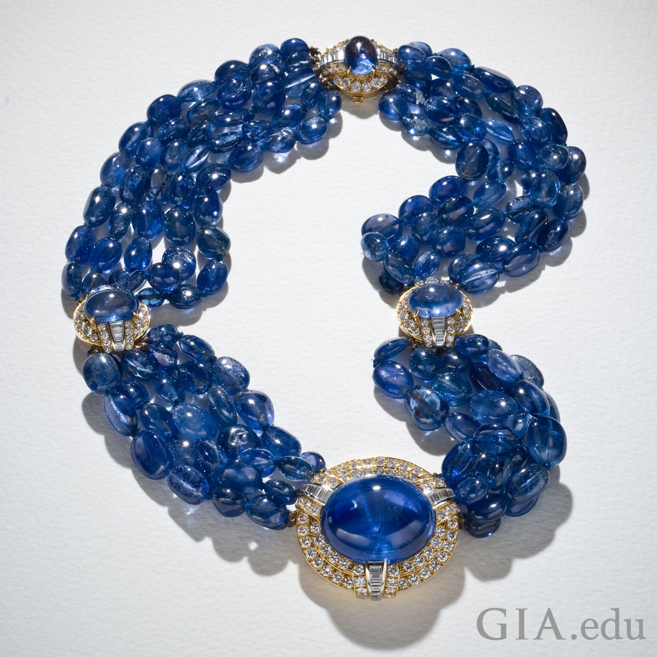 700 carats of sapphire beads and an 80.77 ct unheated cabochon sapphire
