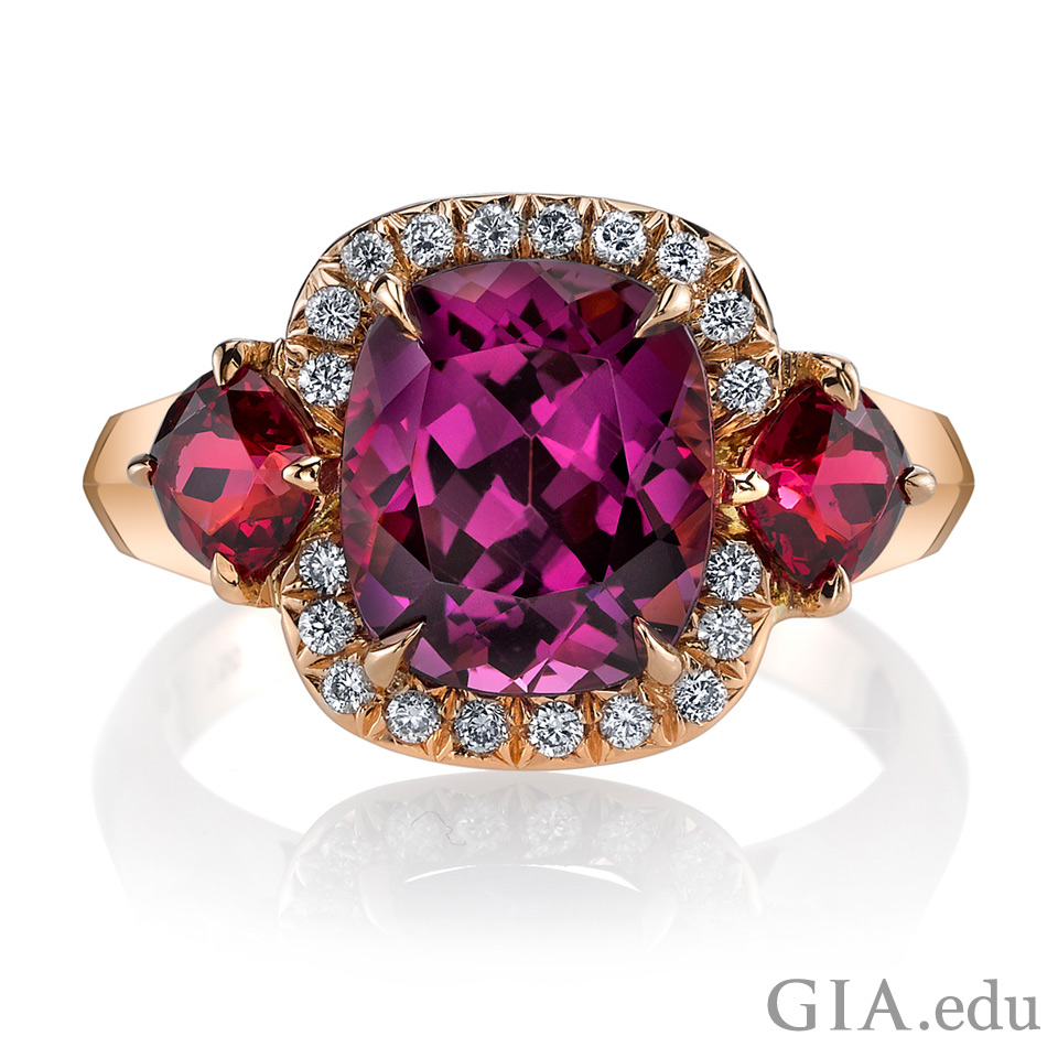 A ring set with a 3.57 ct cushion brilliant purple spinel, 0.13 ct round brilliant cut diamonds, and 0.84 c t red spinels