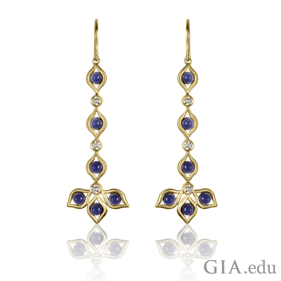 Earrings set with iolite and diamonds