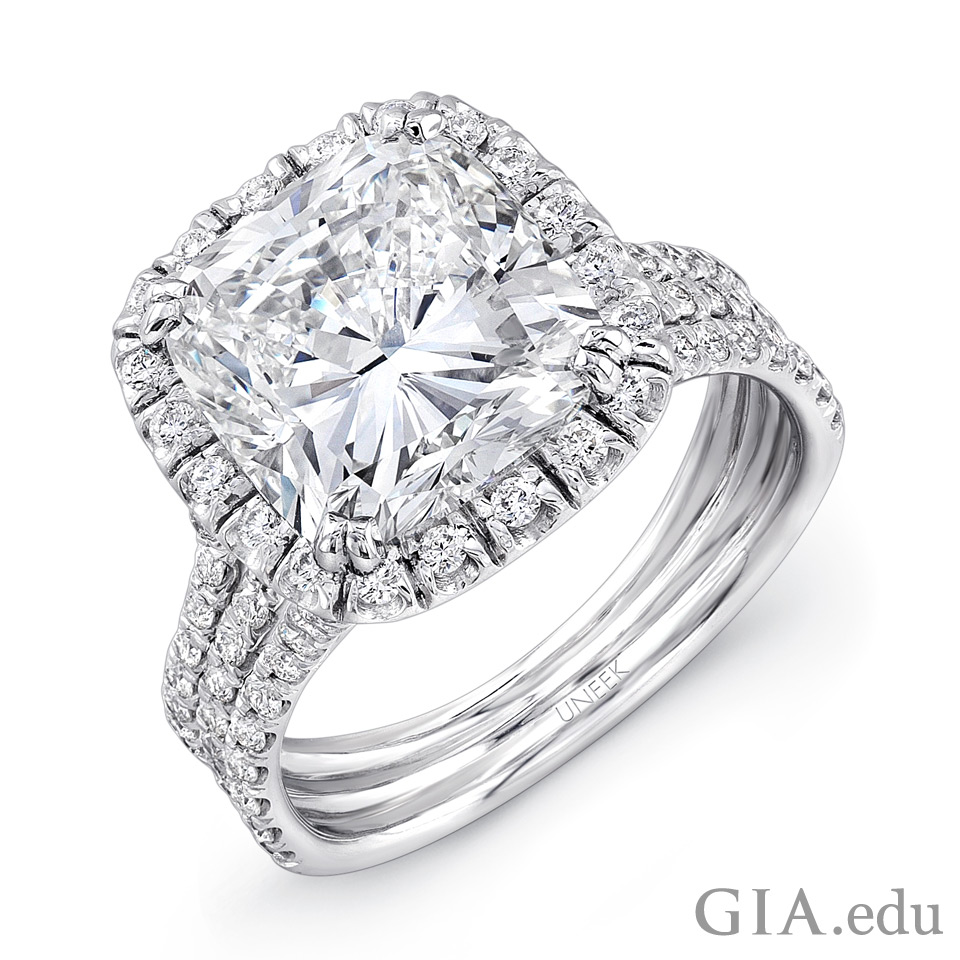 Platinum ring set with a 4.20 ct cushion cut diamond center stone and 99 round brilliants