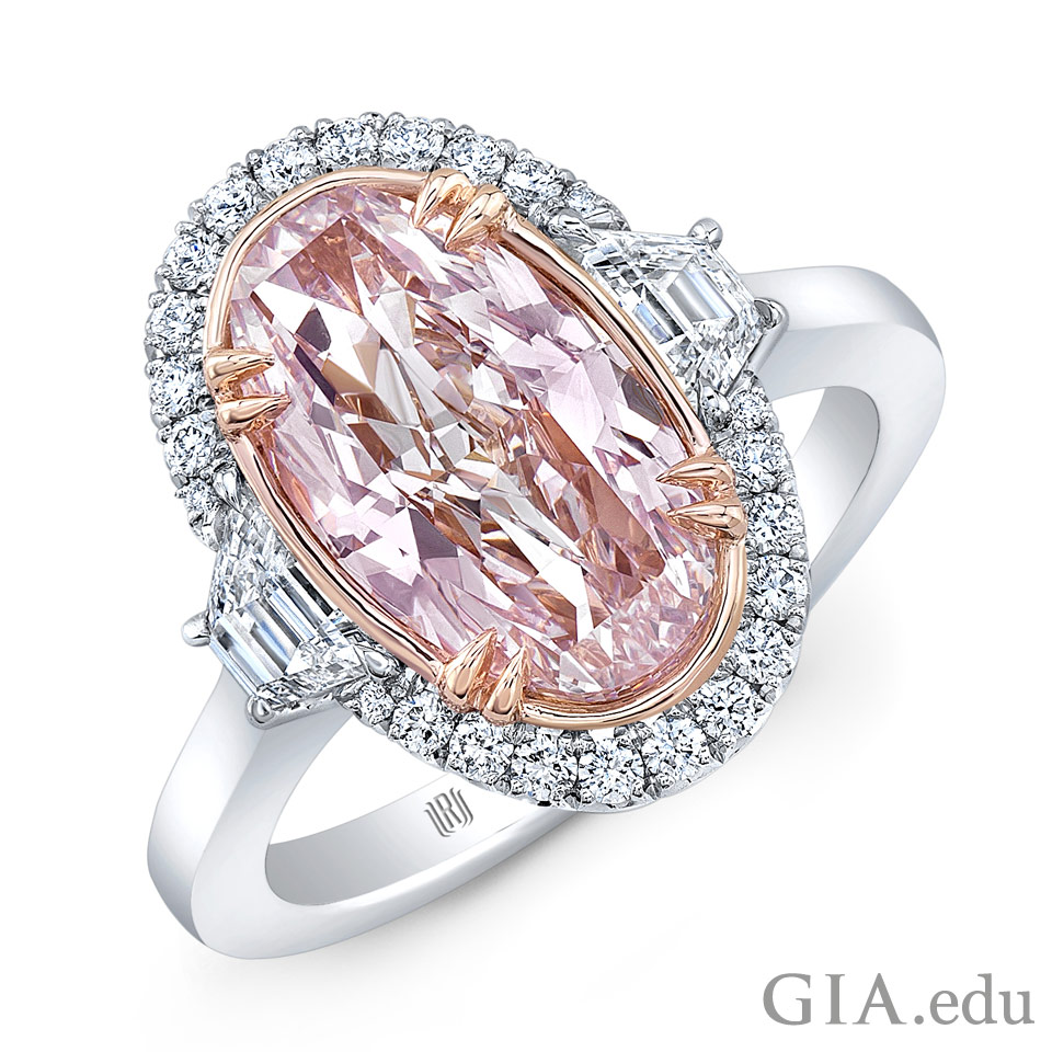 A ring featuring a 2.32 ct Fancy pink oval shaped diamond