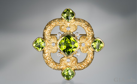 Five Peridot stones designed in a brooch/pendant