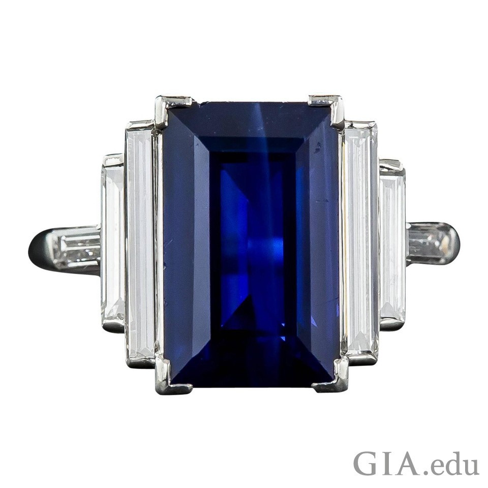 5 ct rectangular step cut sapphire framed by four baguette diamonds
