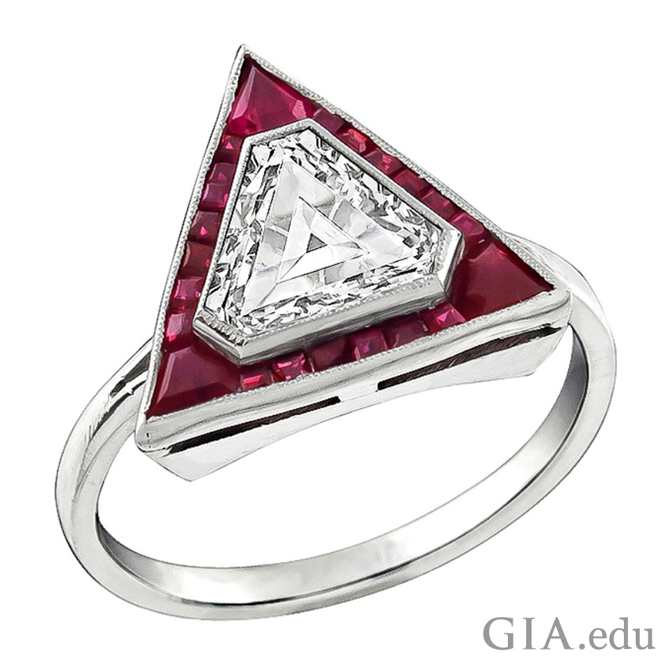 1.17 ct shield- cut diamond framed by rubies totaling 0.40 cts