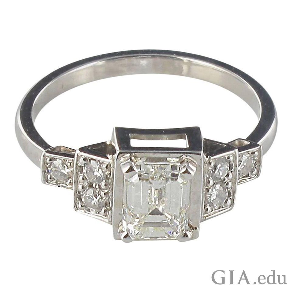 An emerald cut diamond with diamonds on the sides