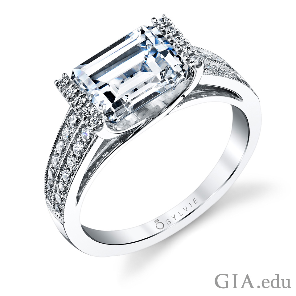 White gold engagement ring with 3 ct emerald cut center stone