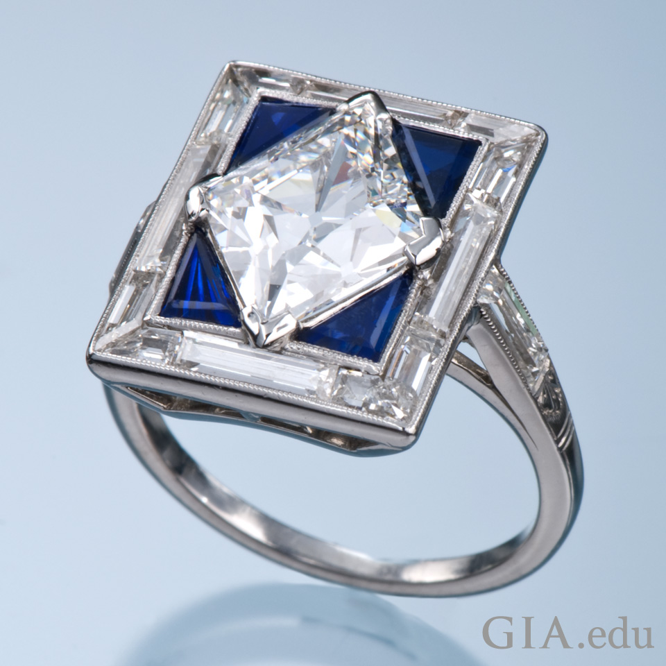 2.42 ct diamond with four triangle sapphires
