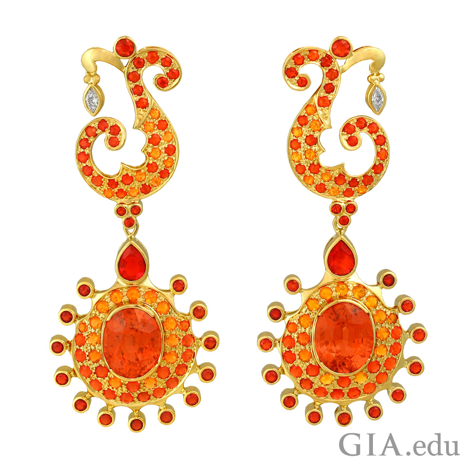 October birthstone earrings consisting of Mexican fire opals, spessartine garnets and diamonds